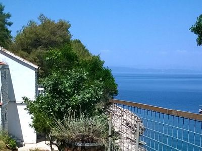 Photo for Two bedroom apartment with terrace and sea view Cove Pobij, Hvar (A-7506-a)