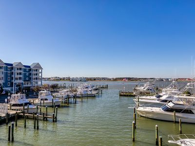 Photo for Bayfront condo w/ marina views and access to shared pool - walk to beach!