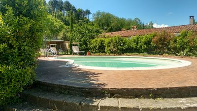Photo for Pisa Florence: charming vacation villa with private garden, swimming pool and a gorgeous view over the hills