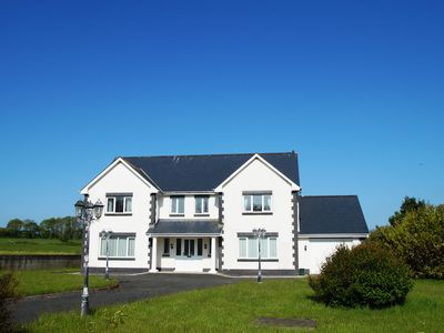 Photo for This grand and modern house, located just 2 miles from the golden sandy beaches of New Quay, offers