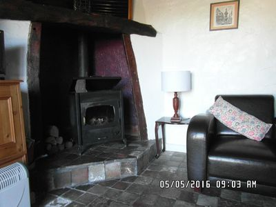 Living room with log burning stove