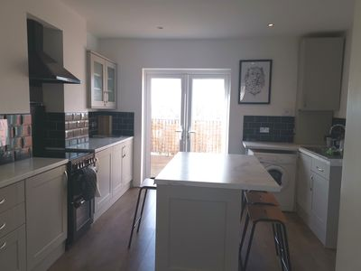 Photo for Classy top floor maisonette near English Channel - sleep up to 8