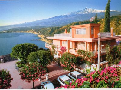 Photo for Residence Schuler Apartments with garden and open view to the sea and Mount Etna