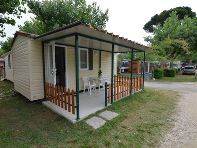 Photo for Detached chalet with terrace in a wooded area near the sea