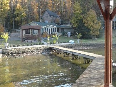 house from pier, small sandy beach area, boatlaunch for small water craft only..
