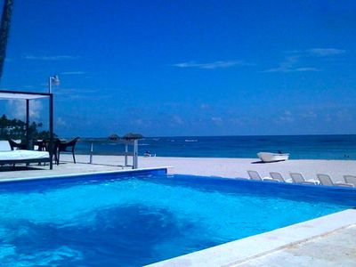 Photo for BEACHFRONT LUXURY CONDO W/POOL.  STEP OUT TO WHITE SAND PRIVATE BEACH.