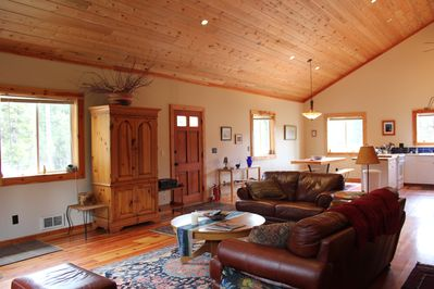 Open Living - Dining Area with vaulted ceilings and comfortable furnishings.