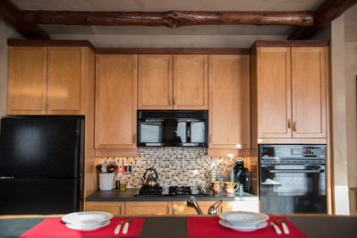 Full Service kitchen with gas cooktop, wall oven, dishwasher, refrigerator