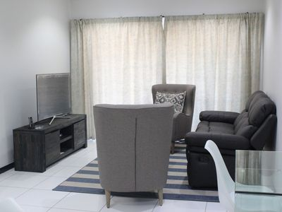 Photo for Two bedroom ground floor condo unit with private garden, 5 min from Monte Casino