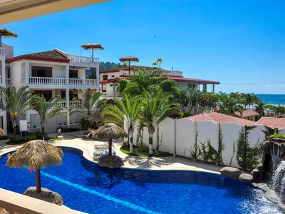 Photo for Beachfront condo with amazing ocean views, shared pools, and a great location!