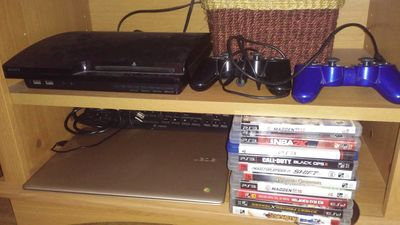living room has PS3 with games and laptop for guest entertainment.