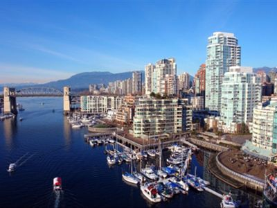 View from Granville bridge, building to the right side by marina & seawall wall