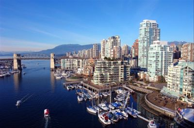 View from Granville bridge, building to the right side by marina & seawall walks