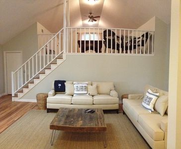 Open concept living area with staircase to the Mahogany pool table loft above