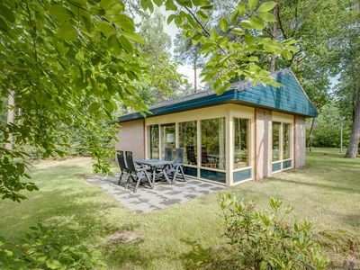 Photo for 4-person bungalow in the holiday park Landal Heideheuvel - in the woods/woodland setting