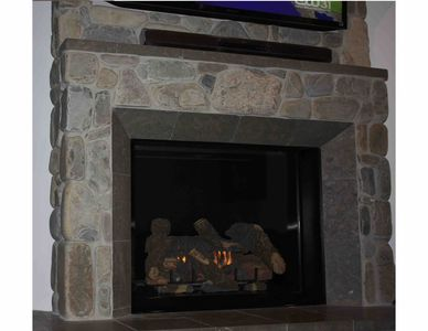 Oversized fireplace and TV with blue tooth sound system.