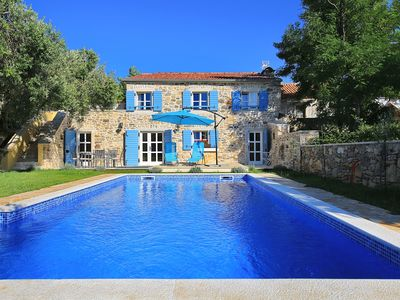 Photo for Luxury stone villa with pool, 350 meters from the beach, with olive garden