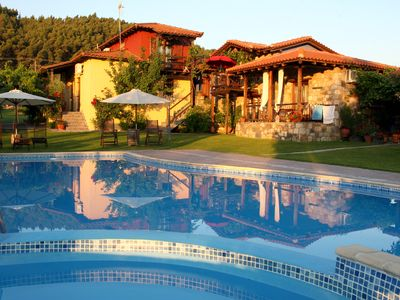 Photo for Sophisticated stone built villa near the beach with pool, in Vourvourou