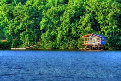 Getaway. This is the boat house and dock below the propety