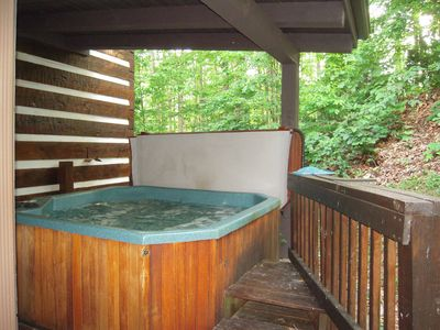 Enjoy the large HOT TUB with a step up for easy in under roof