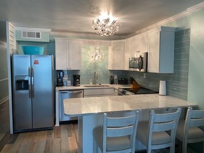 Photo for Immaculate Remodeled  2 Bedroom Ocean Front Condo