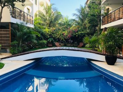 Photo for Encanto Oeste 102 - Poolside Tropical Paradise/ Ground Floor