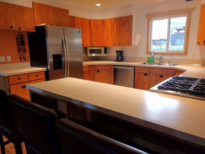 The kitchen has acres of counter space and plenty of light.
