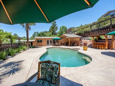 Photo for Charming Pool House with private pool, hot tub, and patio area.