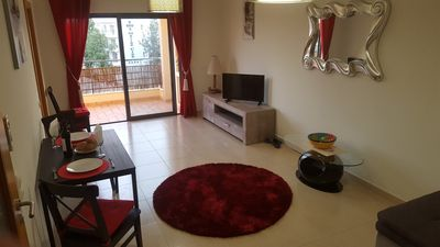 spacious living room with corner sofa double bed