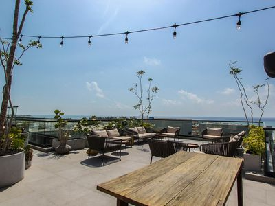 Photo for NEW LISTING! Central condo with rooftop patio/pool, nearby shopping & nightlife