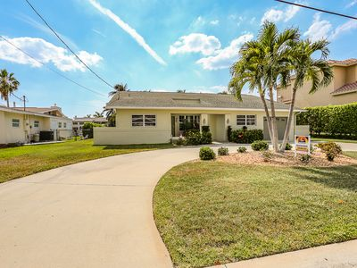 Photo for This lovely vacation home with its lush and beautifully manicured landscaping is located on the mainland of Fort Myers Beach, at 18116 Cutlass Drive.
