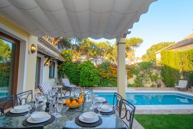Terrace with dining area and large table for eight