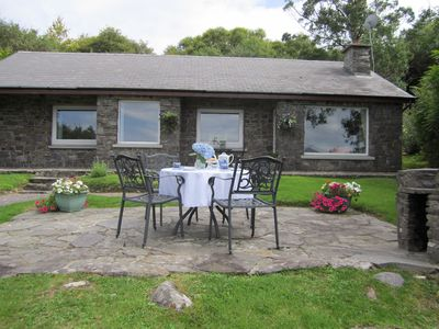 Patio and BBQ area with magnificent views of the lake and surrounding mountains.