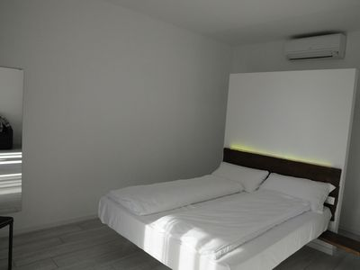 Photo for Modern Holiday Apartment with Wi-Fi, Air Conditioning, Pool, Lake View & Garden; Garage Available, Pets Allowed