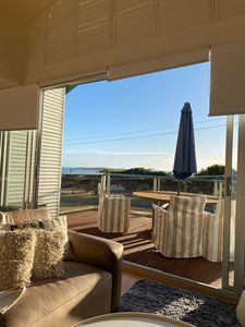 Luxurious leather lounge ,open plan living stacker doors to front deck sea views