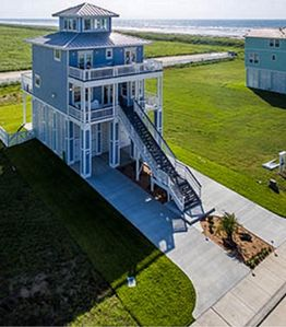 Photo for Enjoy beach living in East Galveston right next to downtown!  4BR 4BA.