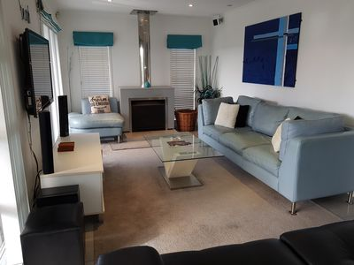 Photo for Modern, spacious & sunny upstairs apartment close to beach & shops