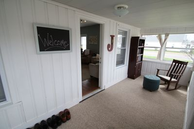 Front enclosed porch with day bed