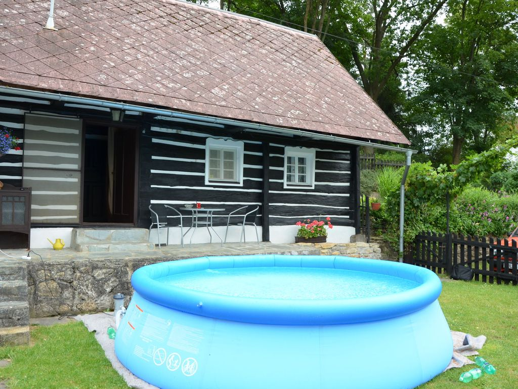 Cozy block house with garden pool at the edge of the for Pool garden edging