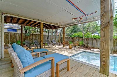 Outdoor patio area with covered deck around the pool area