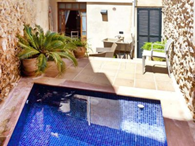 Enticing completely private plunge pool on sunny terrace with barbecue.