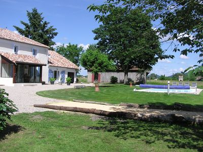 Photo for Beautiful Stone Built Farmhouse, Swimming Pool, 5 acres bordering the River Lot