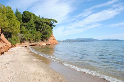 The beach is almost private, suitable for kids.