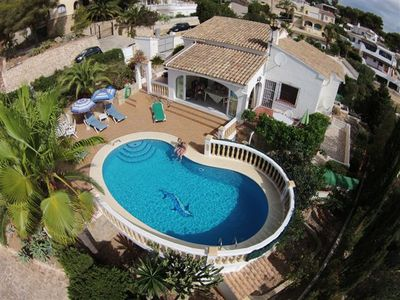 Photo for Detached villa near beach, pool, stunning sea view,aircon,garden, carport