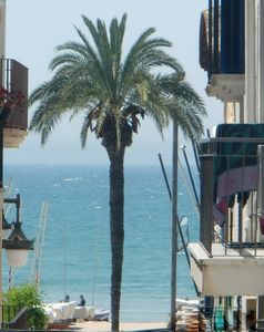 Photo for Sitges centre. Free Wifi. Apartment with balcony overlooking the sea. 10m beach