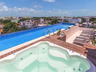 Photo for Studio in Central Playa with Rooftop Pool and BBQ - Velas