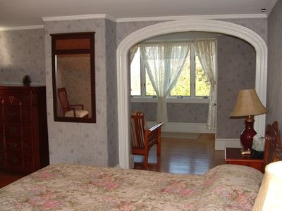 Large Bedroom has a sitting area attached overlooking waterfront