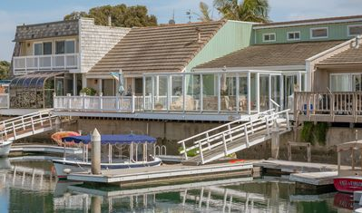 Private L-shaped boat dock accessible from the relaxing and spacious back deck!