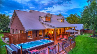 Photo for Country Charmer with Inviting Front and Back Porches, Swim Spa, Decks, Fire Pit