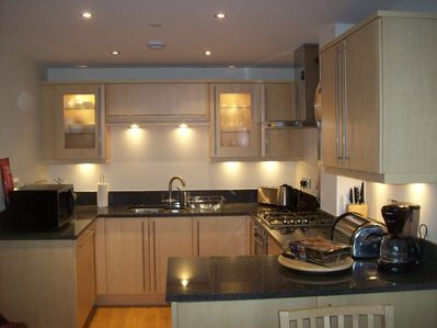 Kitchen with cooker(gas hob/ electric oven) fridge, dishwasher, freezer.
